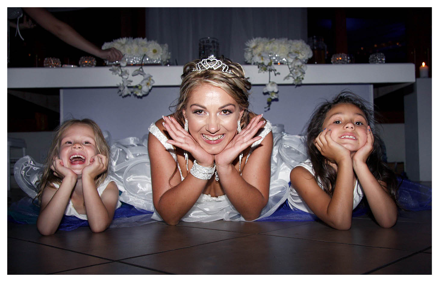 bride with flower girls on the floor with gorgeous smiles