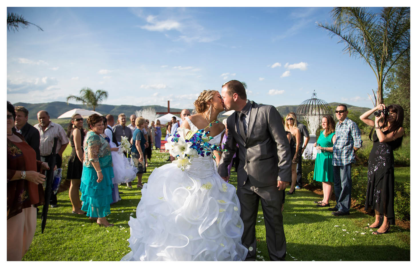 bride and groom kissing with beautiful background after wedding ceremony