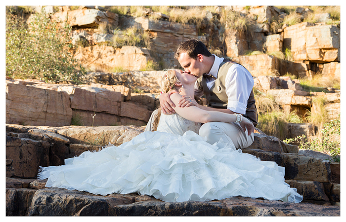 vintage bride and groom on rocks