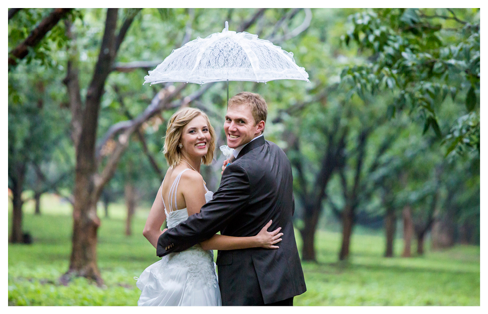 rainy wedding in green leaves peacan nut orchard